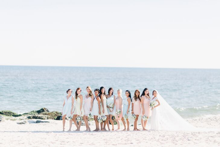 For the bridesmaid dresses, Stephanie chose a mismatched look. Each bridesmaid wore an Alice + Olivia dress in shades of peach, lime and blue. The groomsmen also kept it be achy in tan J.Crew vests and pants.