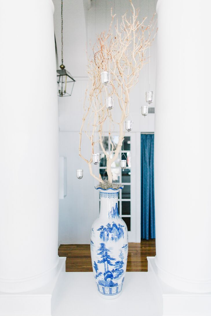 """The reception was decorated in soft blues and whites including a few Chinois printed vases and mini pots that lined the entrance way and for the center pieces. """"I wanted my Father's Chinese heritage to be incorporated into the Beach scene without getting overwhelming,"""" says Stephanie."""