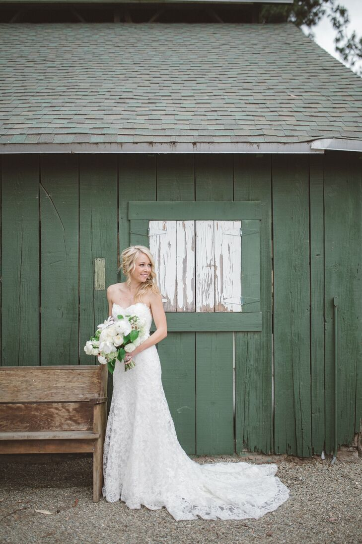 """Christy wore a strapless ivory wedding dress with lace throughout the piece, designed by Maggie Sottero. """"I was looking for something with lace that would go with the romantic feel,"""" Christy says. """"Also, I had always dreamed of having a low back.  This dress had the perfect combination of both!"""""""