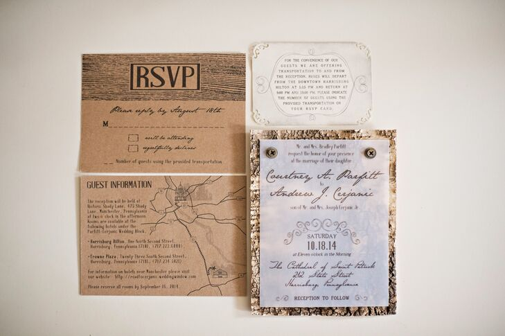 """Courtney and Drew created their own wedding stationery. """"We wanted to incorporate real wood into our invitations,"""" Courtney says. """"But when we priced having invitations printed on wood it was just way over budget."""" Instead, the couple printed their own invitations and attached them to sheets of birch wood with screws."""