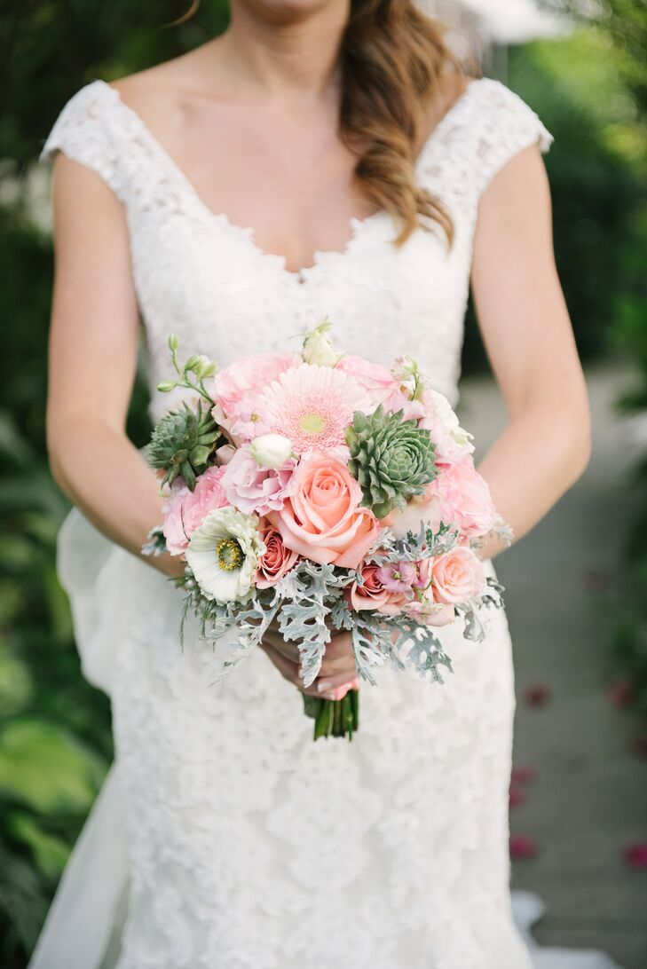 The bridal bouquet featured peach and pink roses tucked in with green amaranthus, succulent and peach gerbera daisies.