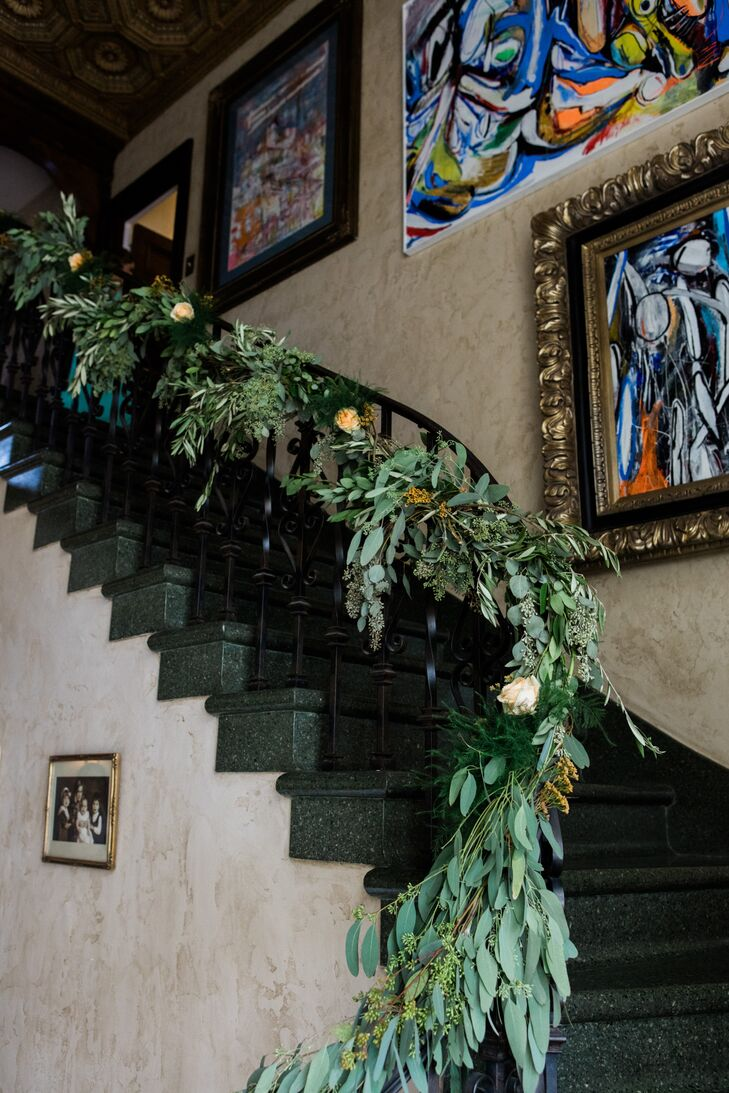 Greenery and rose garlands were wrapped around the banister to dress up the space and add a memorable, elegant detail inside the residence.