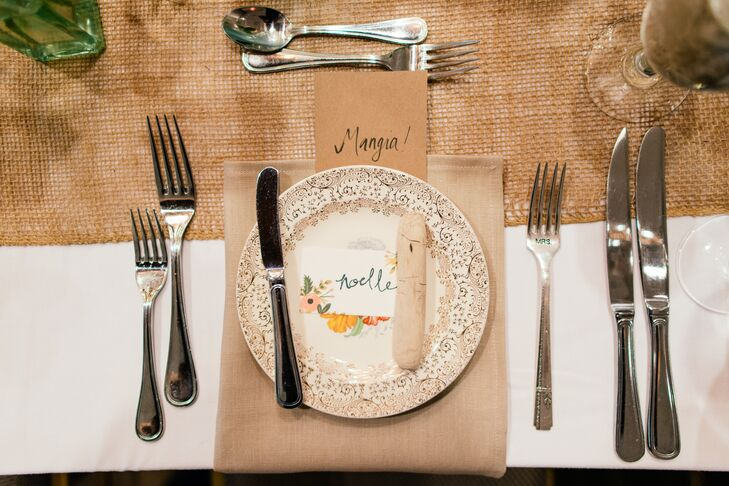 To carry over the laid-back bohemian feel of the ceremony, Noelle and Patrick went for a rustic chic aesthetic for their reception tablescapes. Tables were dressed in burlap and neutral colored linens and decorative floral dinnerware, floral place cards and pieces of driftwood added a note of beachy, vintage flair to each place setting.