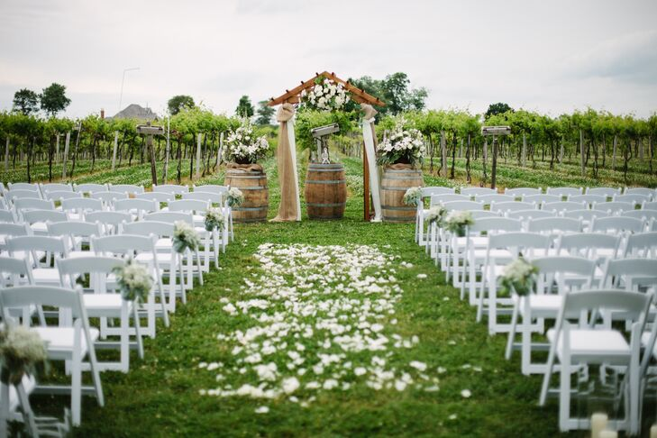 Katie And Ben Exchanged Their Vows Under A Wooden Wedding Arch D With Burlap White