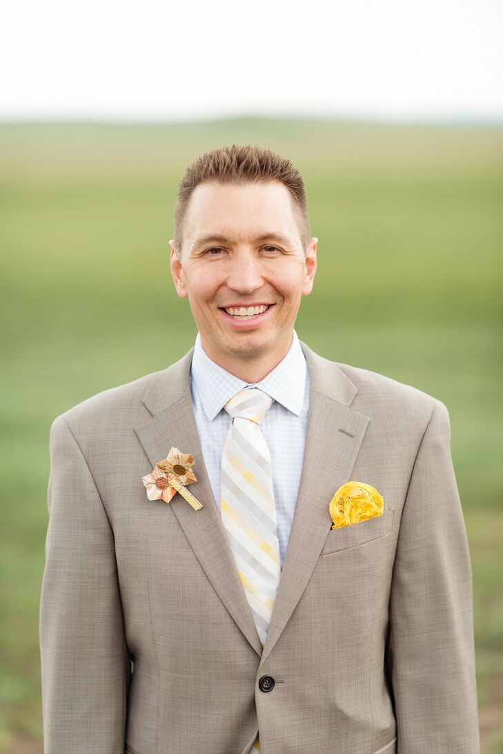 "Jason wore a taupe linen suit with a plaid tie in the same yellow as Shauna's dress. ""I used the leftover fabric from my altered gown to make the groom's pocket silk,"" she says. ""He did not know what color dress I was wearing until it was revealed on our wedding day. I wrapped up his tie, socks and pocket silk and had it delivered to his room before he got dressed. It was at that moment he discovered that I was wearing a yellow dress."""