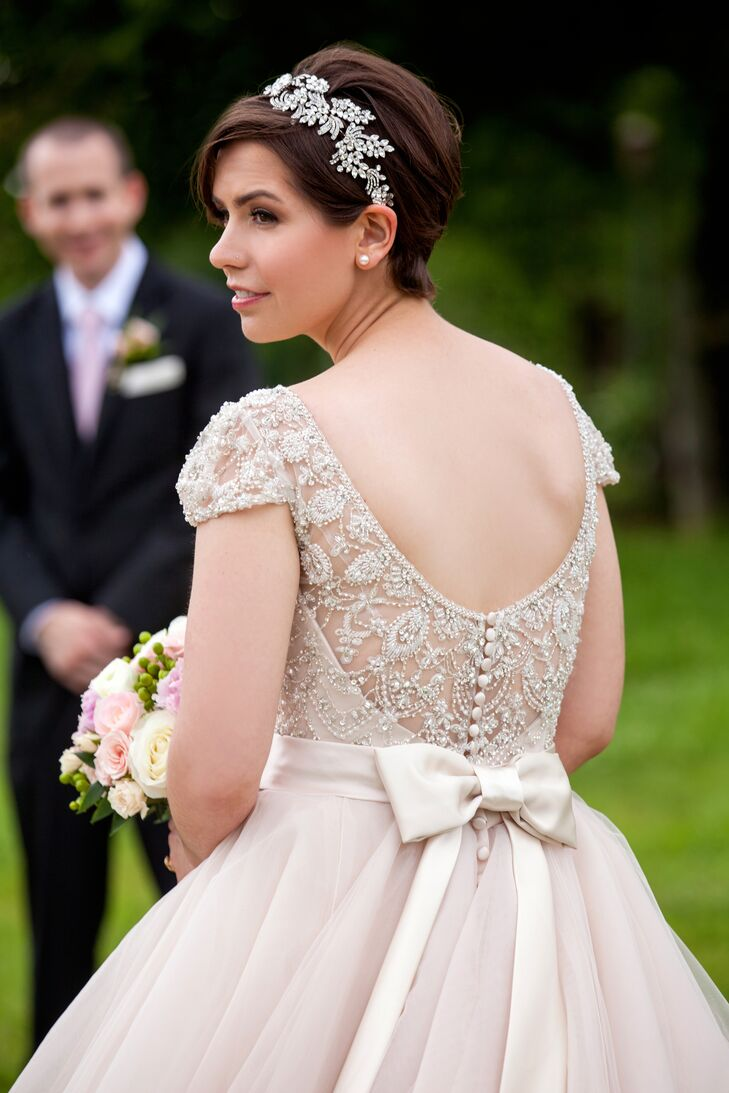 Since she has always loved dress-up clothes, Haley was excited to go dress shopping. She found a stunning champagne-colored ball gown by Allure Bridals at Posh Bridal. She loved the playful yet elegant skirt, ornate beaded detailing, low back and big satin bow for a modern but classic look.
