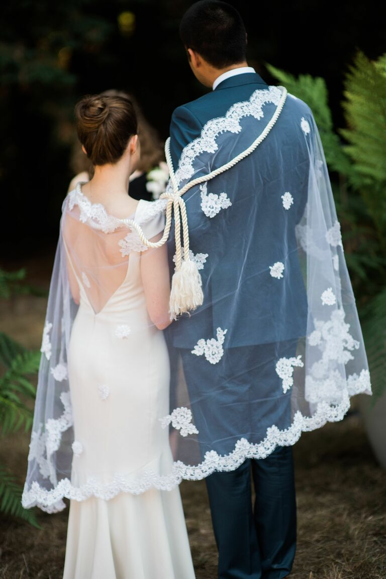Couple during Filipino veil and cord ceremony