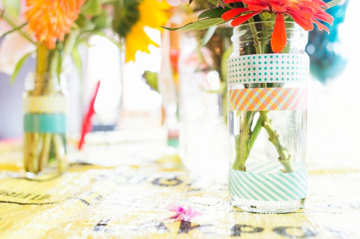 """All of the vases that held the flowers came from months of Jason and I recycling jars,"" Shauna says. ""I embellished the jars with washi tape from Paper Source."""