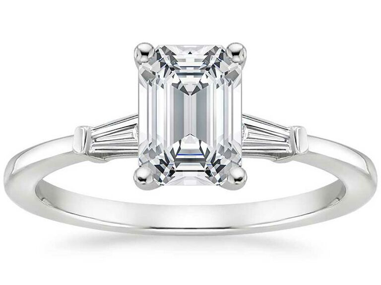 Emerald-cut engagement ring with baguette side stones on white gold band