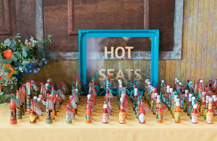"""Since I grew up in San Diego and Jared grew up in Houston, we knew from the outset we wanted Mexican food at our wedding, and we just kind of went from there,"" explains Jordy. In keeping with this theme, guests found their seats thanks to miniature bottles of hot sauce."