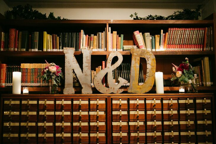 Large metal letters (the couple's initials) were displayed above a vintage library card catalog.