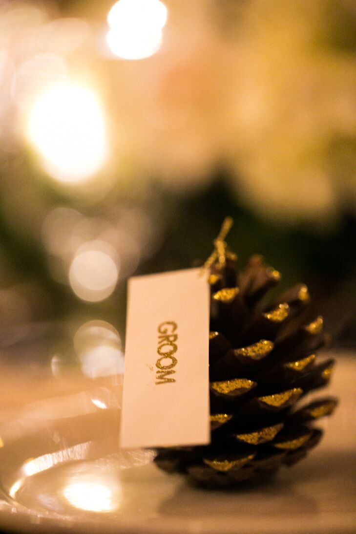 Pinecones were covered in gold glitter to serve as the escort cards.