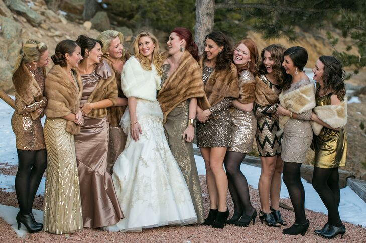 Inspired by their New Year's Eve wedding date, the bridesmaids wore their own metallic gold dresses. They completed the look with black ankle booties and fur stoles to match the winter look.