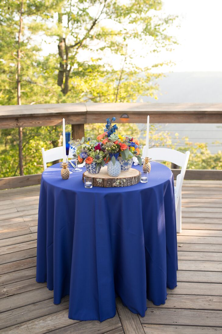 Bold Blue Sweetheart Table with Wood Slice Centerpiece