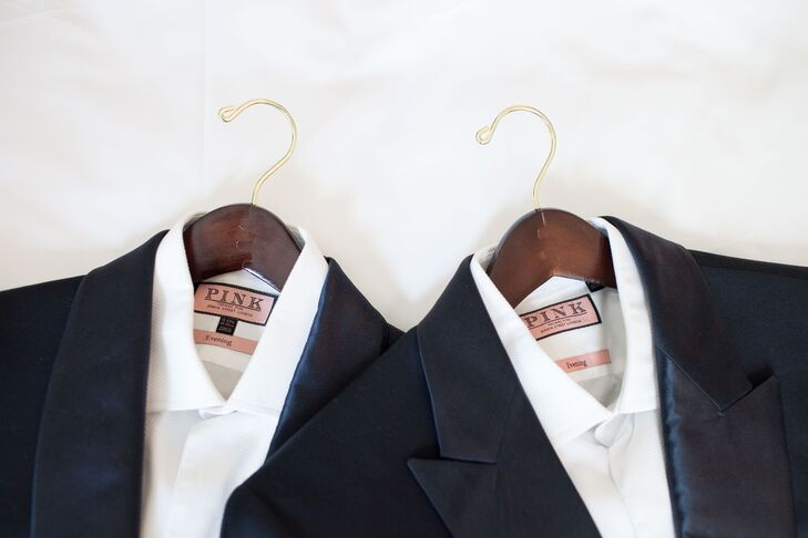 "The grooms' tuxedos were custom made by fashion designer Borris Powell (also their good friend) in matching midnight blue fabric ""but with our own options for lapels,"" Justin says. They wore black bow ties with a checked pattern and ""a fantastic pair of black Louboutins."""