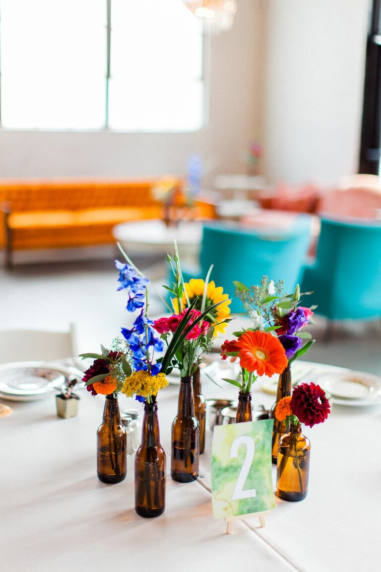 Cluster centerpiece with wildflowers in brown glass bottles