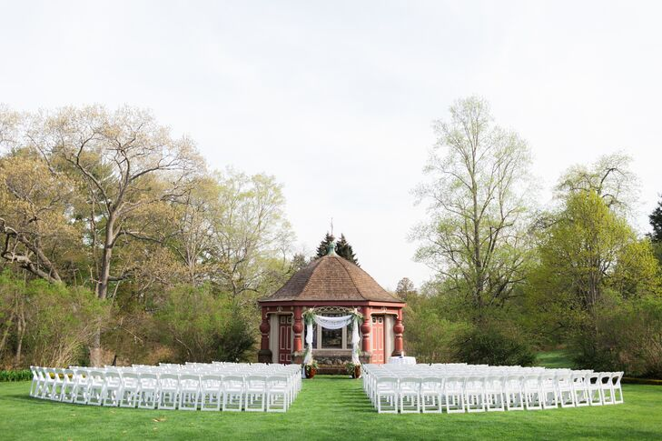 The couple's ceremony took place on the lawn at the Estate at Moraine Farm in Beverly, Massachusetts, with a teahouse in the background.
