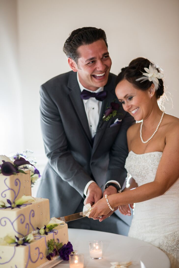 Tanya and Cody enjoyed a three-tier square cake with purple and silver detailing and topped with purple calla lilies.