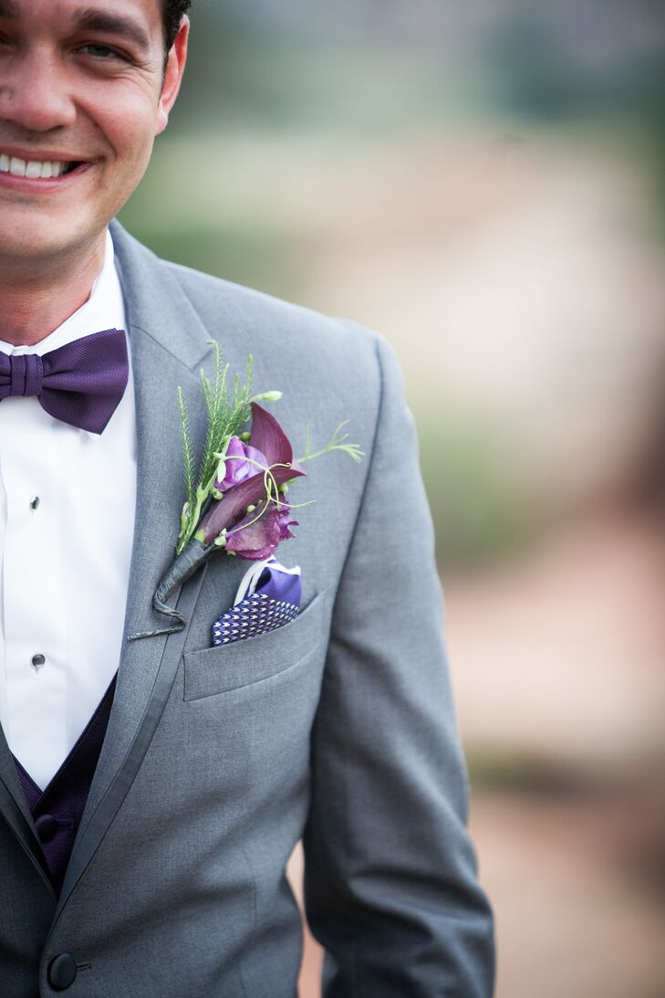 Cody wore a purple calla lily and pine boutonniere on his lapel.