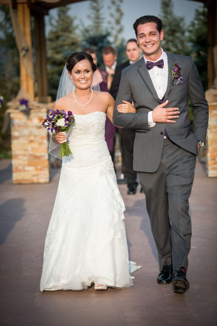 Cody wore a gray tuxedo with a purple vest, pocket square, bow tie and socks to match the wedding colors.