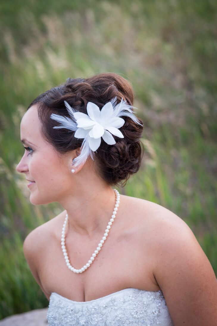 Tanya wore a fabric stephanotis and feather hair accessory instead of a traditional veil.