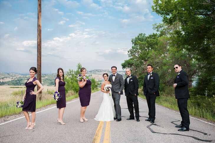 The bridesmaids wore knee-length purple dresses with nude shoes, and the groomsmen sported classic black tuxedos with black bow ties.
