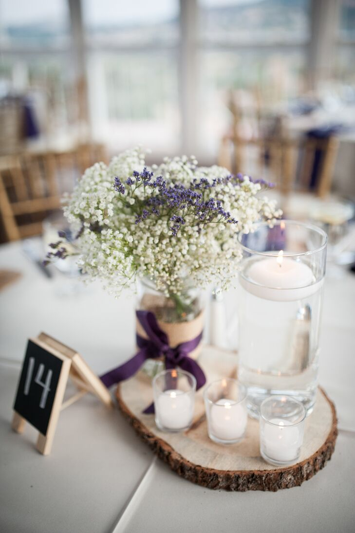 The centerpieces included baby's breath and lavender in burlap-adorned mason jars and floating candles on top of wood rounds.