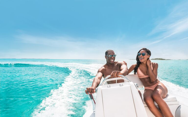 bahamas couple on a boat laughing best honeymoon destinations for 2021