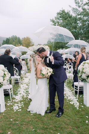 Couple Shares Kiss Under Umbrella During Rainy Recessional