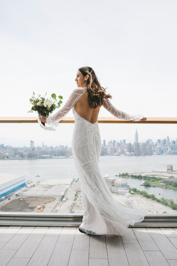 """I am not into traditional, princessy wedding dresses. I knew I wanted something comfortable but still flattering—something that felt like me,"" says Amanda, who donned a Vera Wang sample dress that she got for a discount since it was damaged. ""The dress was looking a bit rough on the hanger, but I knew it had potential. I couldn't pass up this Vera Wang gown for the discount price. I worked with my amazing tailor, Amanda Madden, to get it into a shape that I loved."" Two feet was cut off the train, and the gown's lace was cleaned and restored."