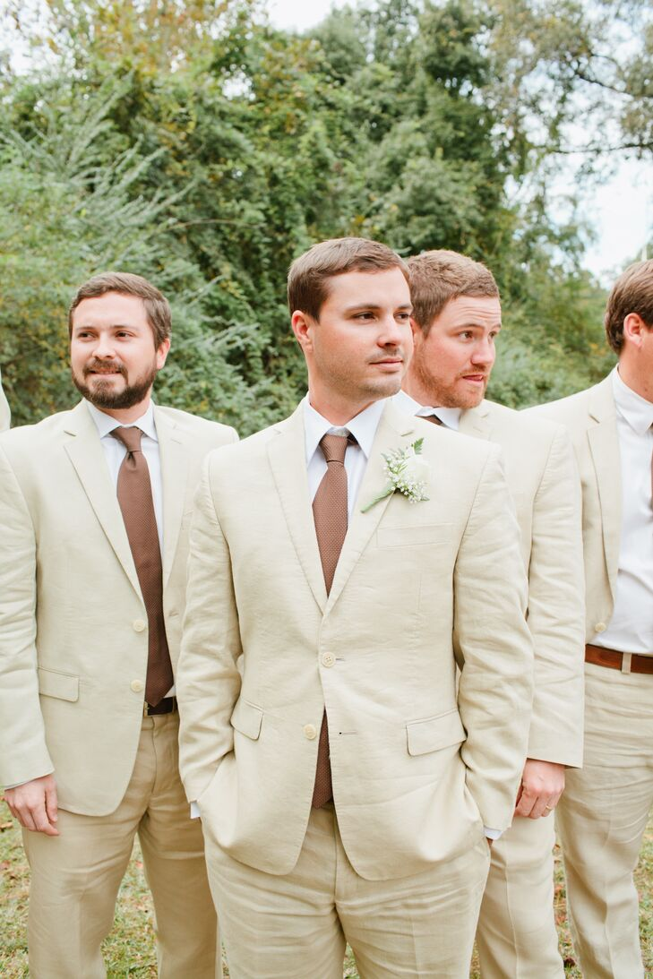 Groomsmen in Tan Tuxes with Mauve Ties