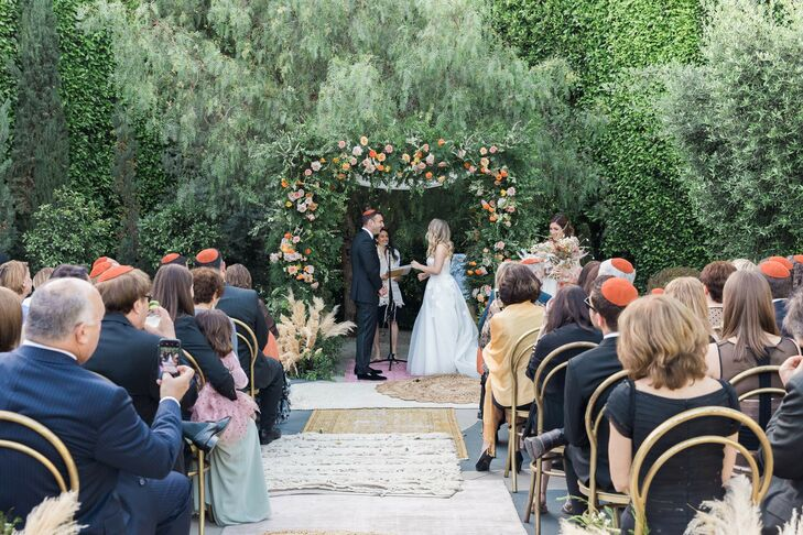 """For their wedding, Hayley and Eric Levy wanted to """"combine the laid-back, boho ambience of California with the sophisticated, mid-century modern and a"""