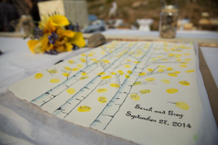 The guest book was a painting of a Colorado aspen tree and guests stamped their yellow fingerprints onto the branches to match the wedding colors.