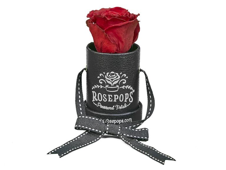 Single red preserved rose in black leather case