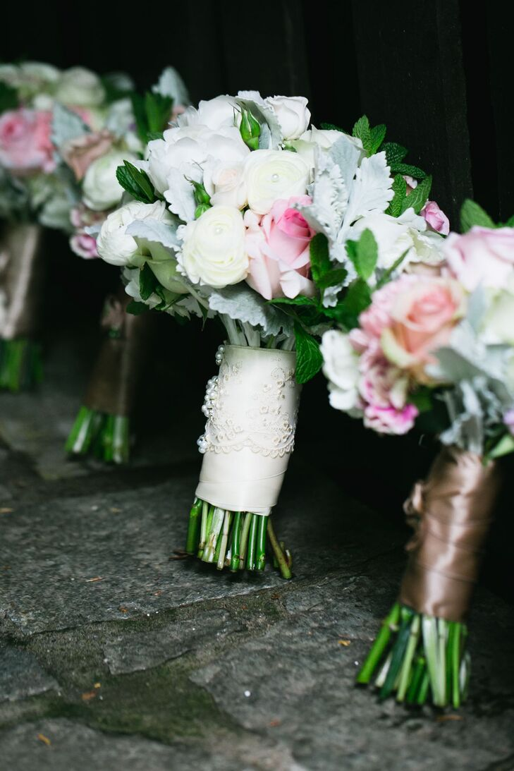 """Raquel chose a pastel-colored lush bouquet arranged with a mix of roses, peonies and dusty miller, which was wrapped in white ribbon and lace. """"Since it was springtime, the flowers were all in perfect season, and the colors were all in the muted pastels as well,"""" Raquel says."""