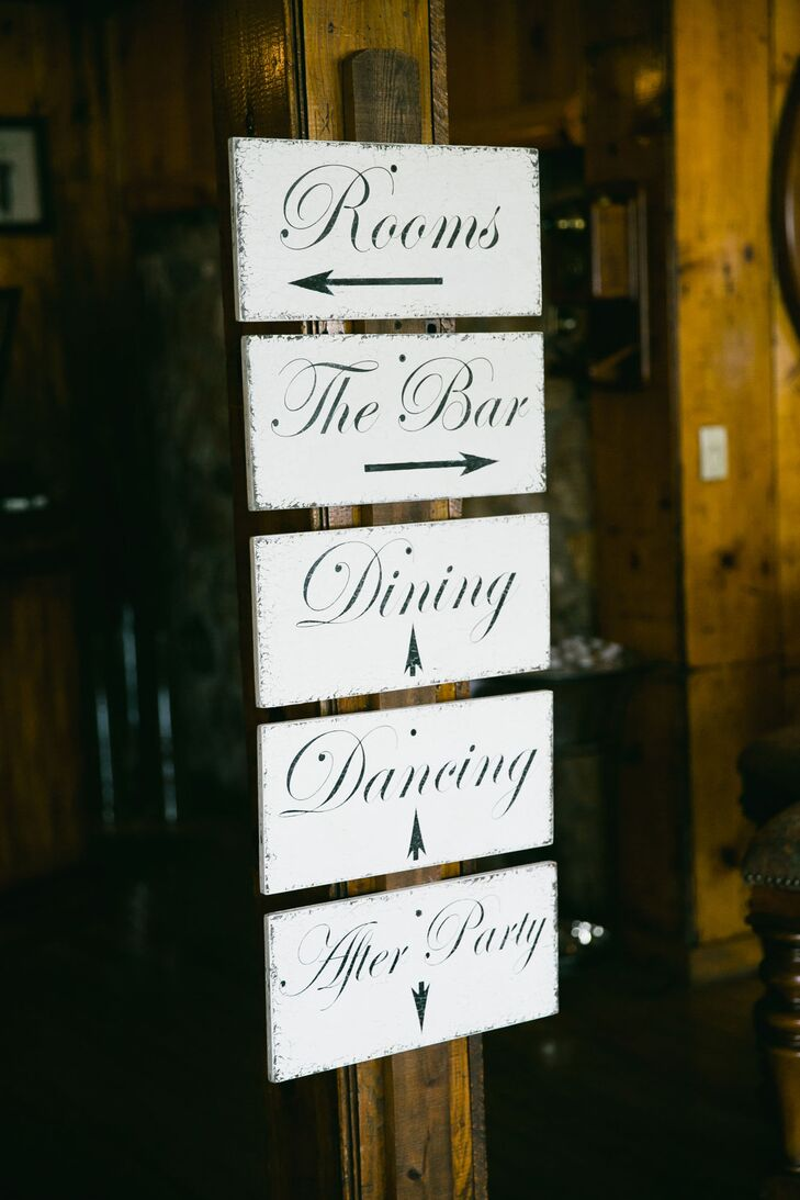 """Inside the three-story reception lodge, a black-and-white wooden sign pointed guests in the right direction for the evening's festivities. """"The reception was held on the middle level and then the third level was the party floor,"""" Raquel says. """"After the reception was over, everyone headed downstairs for the after-party."""""""
