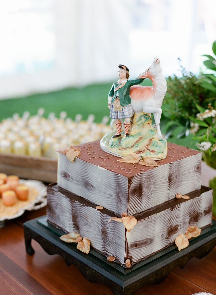 In lieu of a more traditional topper, the couple finished their two-tier faux-bois cake with a vintage Staffordshire figurine borrowed from Hallie's parents.