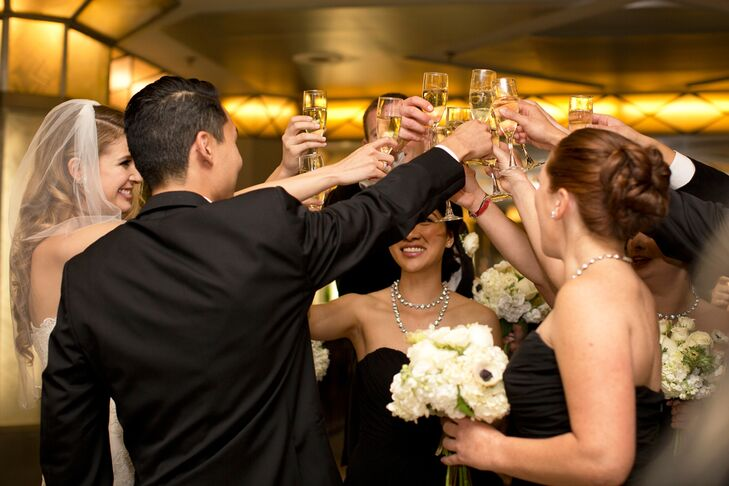 Wedding Party Toasting to Married Couple