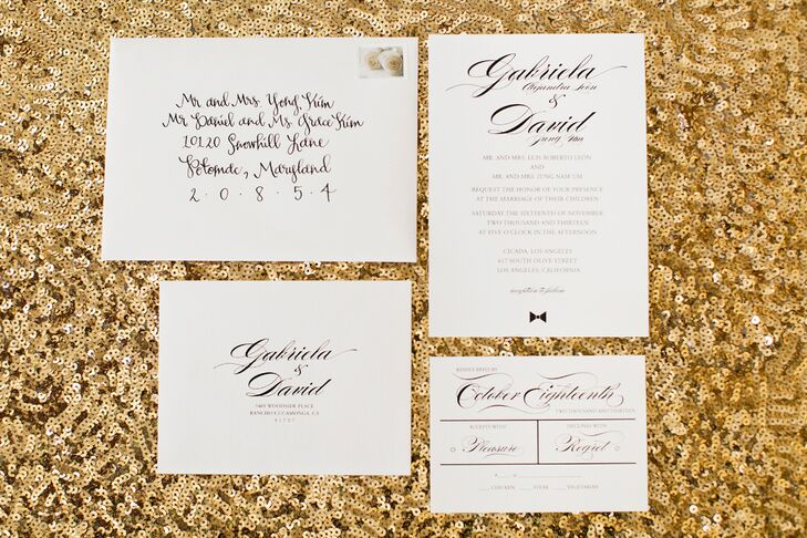 Tawny Tsang Calligraphy designed the elegant white wedding invitations with classic black script letterpress.