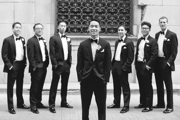 David and his groomsmen all wore fitted black tuxedos by Vera Wang with black bow ties, creating a classic look for the wedding day.