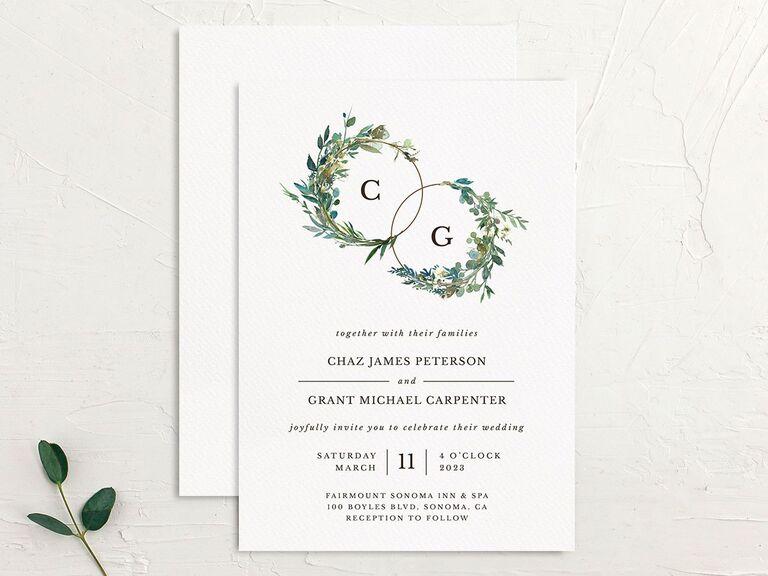 Rustic wedding invitation with greenery