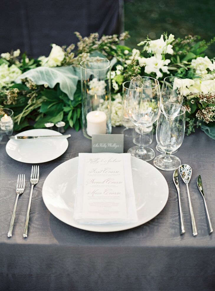 The place settings were kept simple and classic with white china and hand calligraphed menus and place cards.