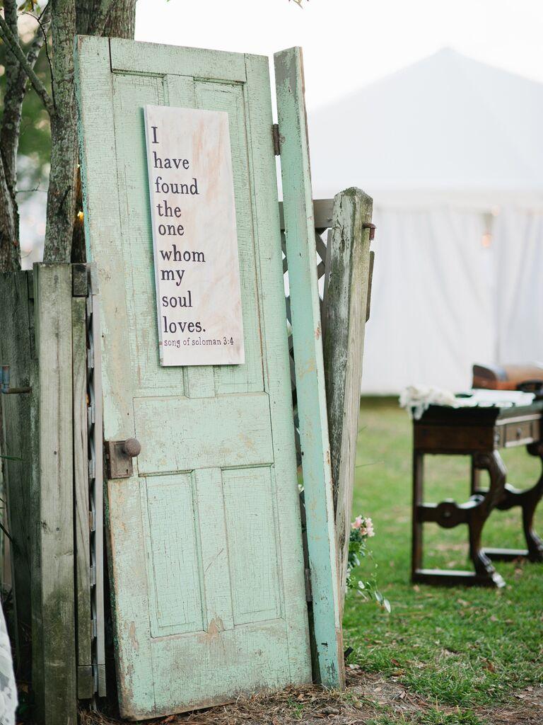 vintage door with rustic wood wedding sign