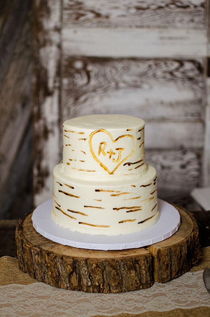 Going along with their natural, rustic theme, Jada and Ryan's wedding cake was perfect. It looked like birch wood, with their initials carved in the center.