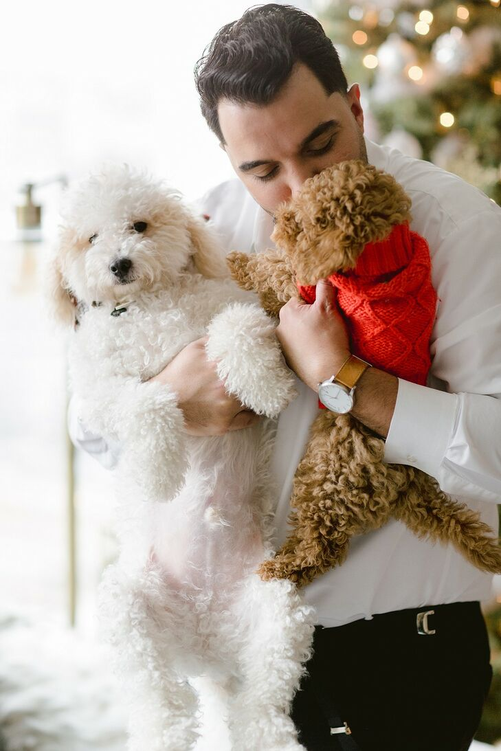 Groom Cuddles with Dogs While Getting Ready