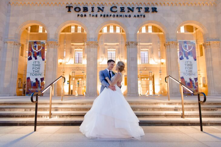 To keep travel time low and uncomplicated, the ceremony and the reception were at the modern Tobin Center for the Performing Arts in downtown San Antonio, Texas. The breathtaking floor-to-ceiling lights and monstrously tall ceilings gives the space a chic ambiance.