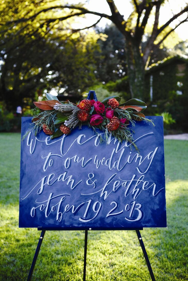 A chalkboard welcome sign greeted guests at the ceremony site.