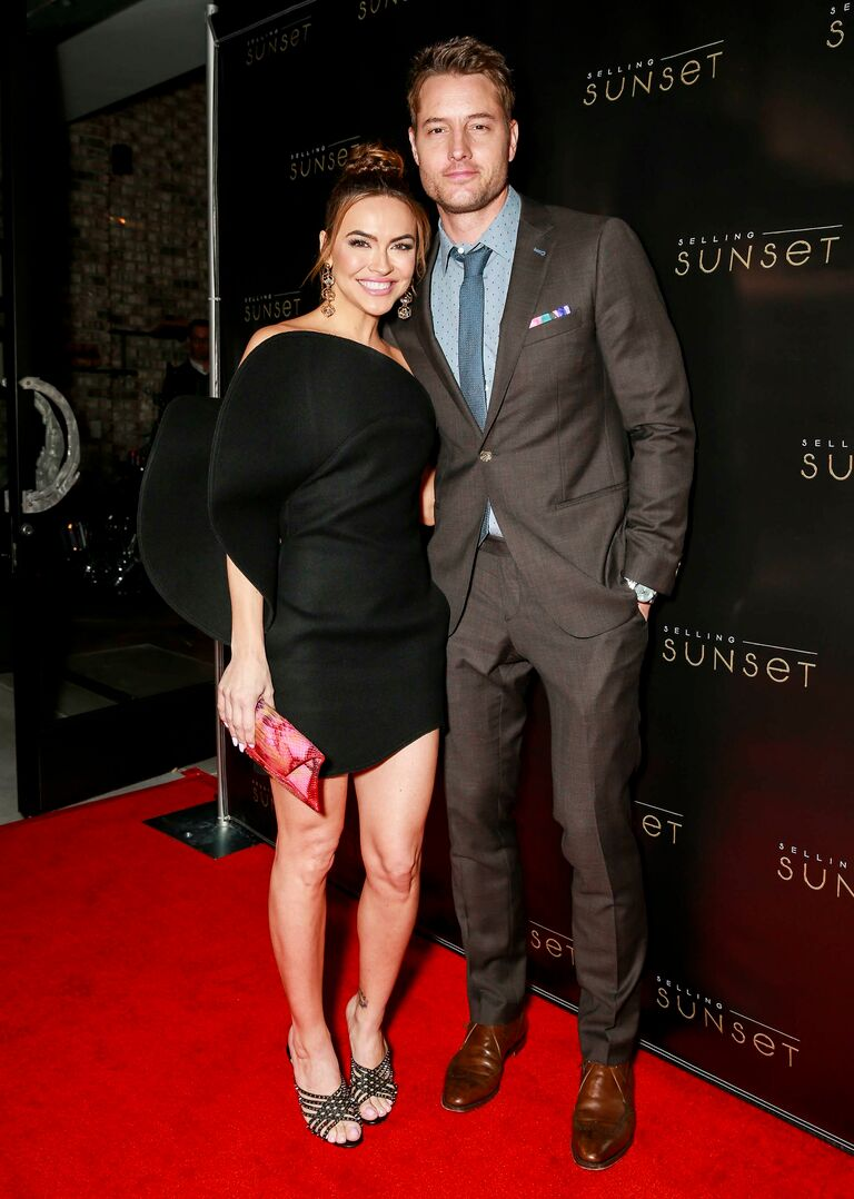 justin hartley chrishelle stause at the selling sunset premiere in march 2019