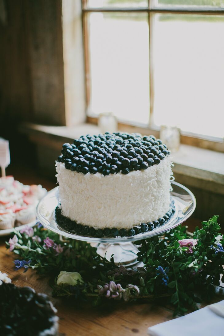 The sweet coconut wedding cake was topped with fresh blueberries.