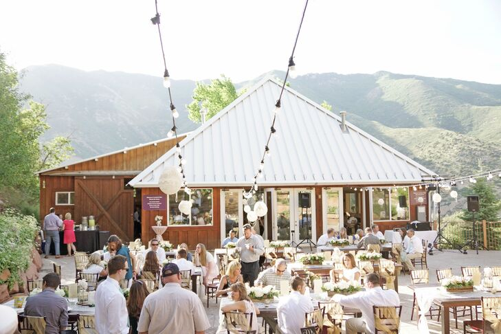 Bistro lights illuminated the reception at Louland Falls in Salt Lake City, Utah, where Ashlee and Dallan's 200 guests enjoyed dinner and dancing alfresco.